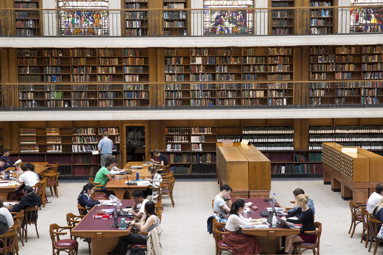 People studying and working in the Mitchell Library Reading Room
