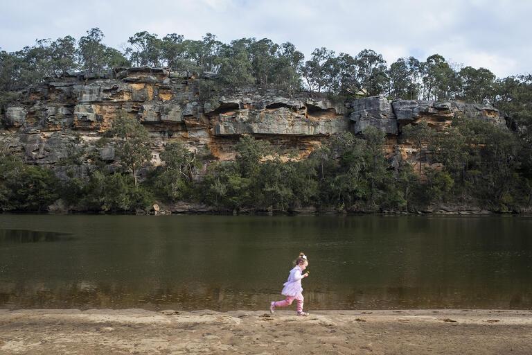 Wowawme rock shelf, Sackville Reach on Dyarubbin (Lyra, great-granddaughter of Darug Elder Aunty Edna Watson, in foreground)