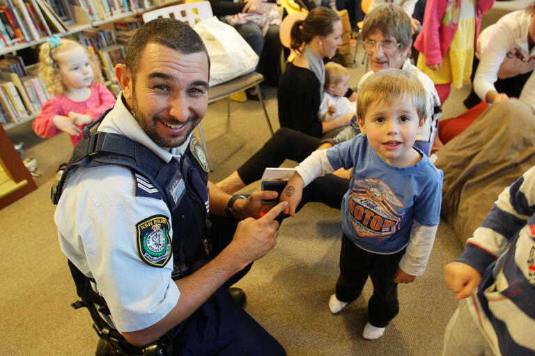 Police officer with young child