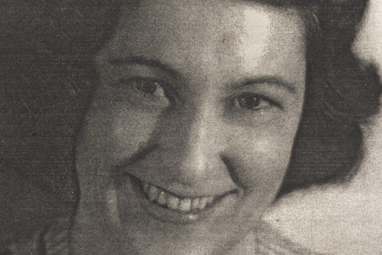 Close up black and white photograph of Olive Cotton's face.