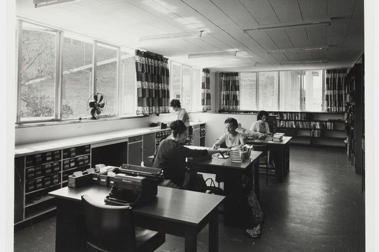 BW photo of women working at desks