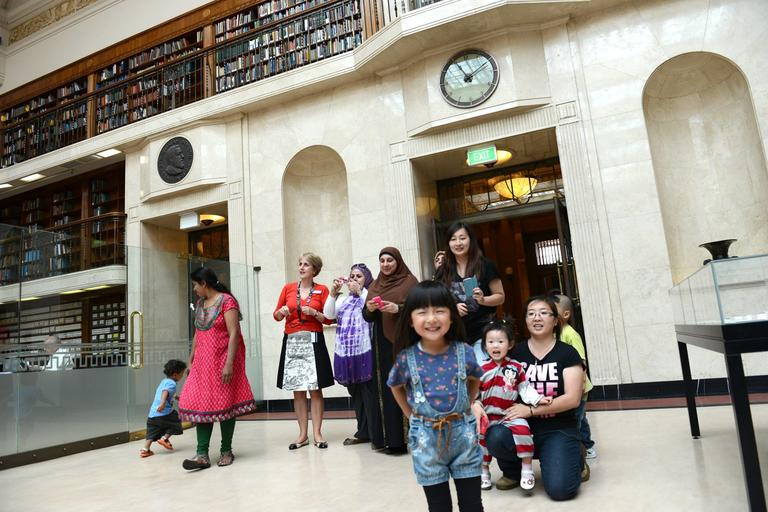 A group of children and adults on a Library tour.