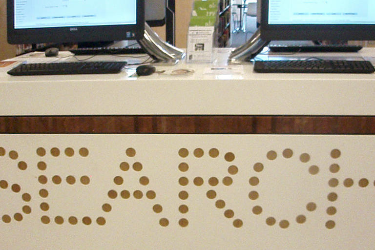 library service desk with public access computers - Bankstown Library