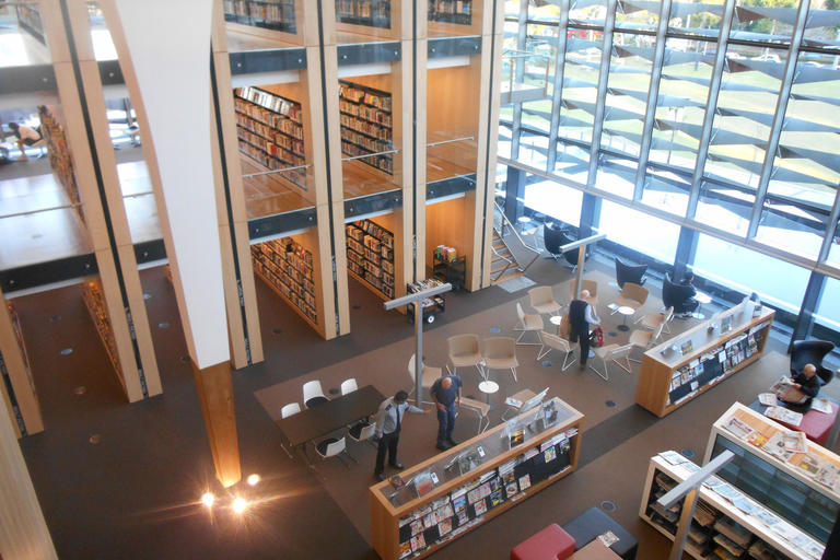 High bookshelves and glass walled room taken from above - Bankstown Library