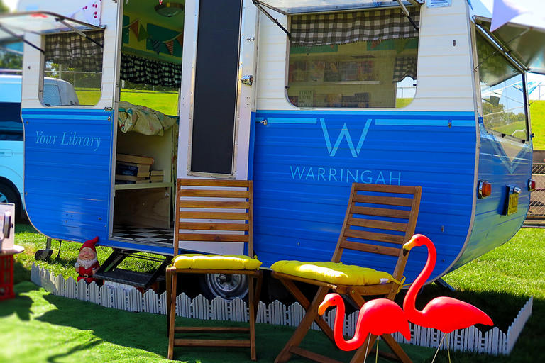 Blue caravan with library signs on it - Warringah pop-up library
