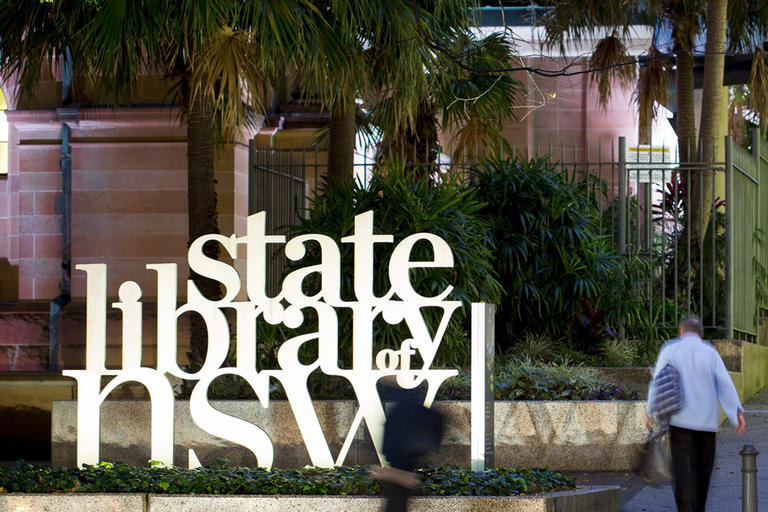 Exterior of State Library NSW on rainy day with customers entering