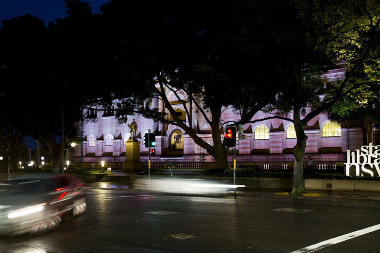 State Library NSW at night bathed in pink light