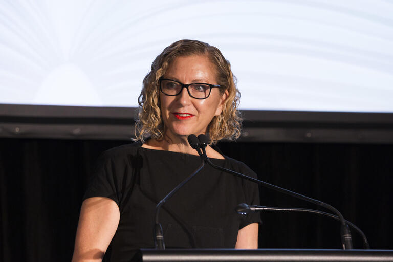 Photograph of Joanna Murray-Smith at lectern
