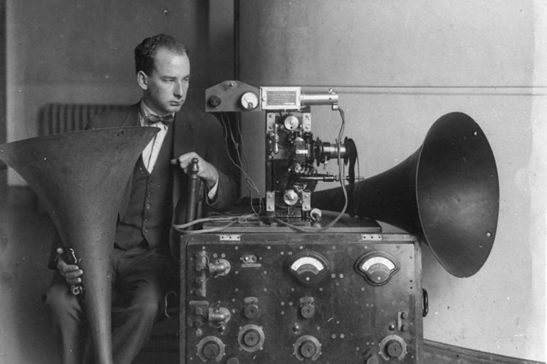 Man using old phonograph sound machine