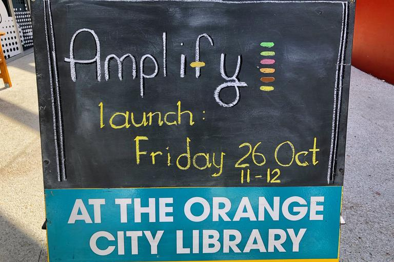 Sign from Amplify launch at Orange City Library