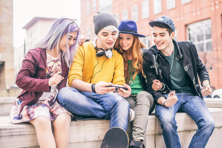 Four young people laughing at something