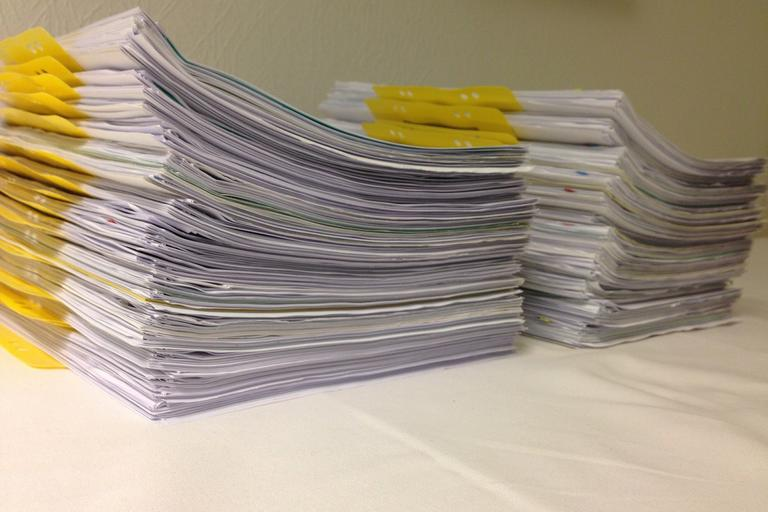 Piles of forms on desk