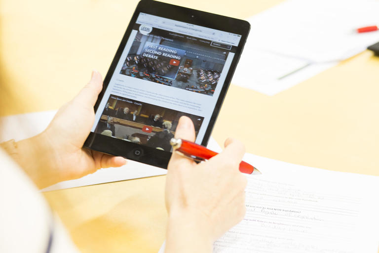 Person holding ipad with legal information displayed