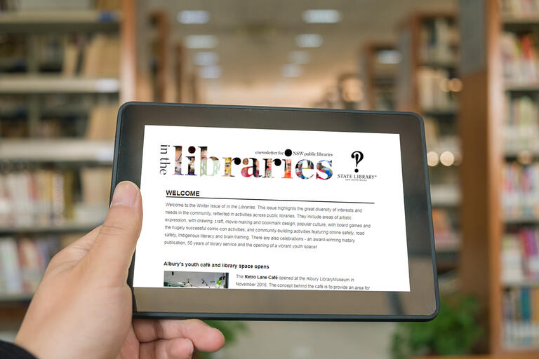 Newsletter screenshot on an ipad in a library