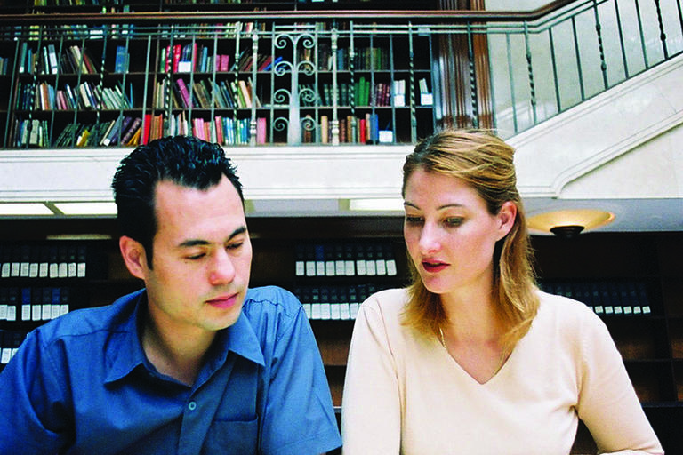 Man and woman in Library studying books