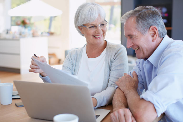 Man and woman looking at laptop