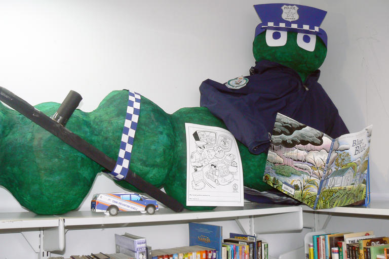 Toy Very Hungry Caterpillar dressed up as a police officer