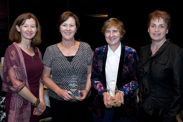 Library staff holding awards