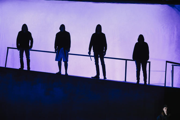 silhouette of 4 men from lost boys play