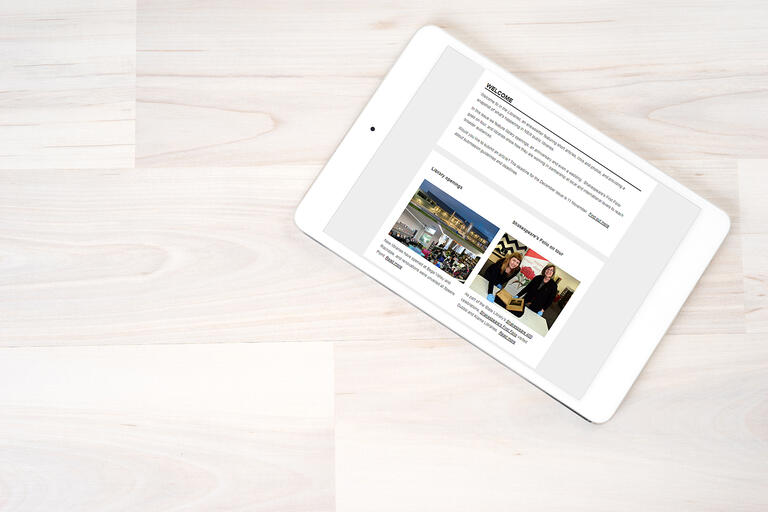 iPad on desk with an enewsletter displayed on the screen