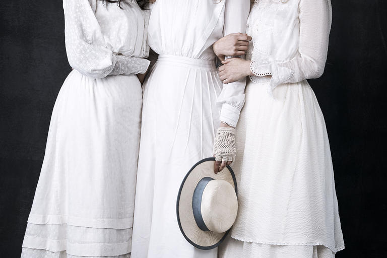 3 women dressed in period clothing from picnic at hanging rock tv show