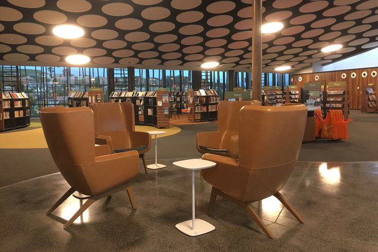 Seats and tables in a library entrance area