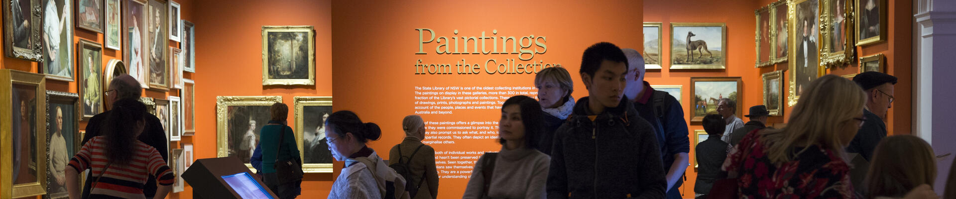 A group of people in a painting gallery