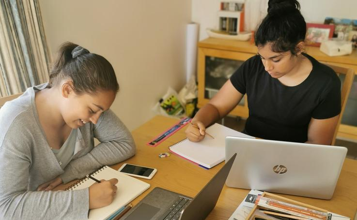 Photograph of two students studying at a desk