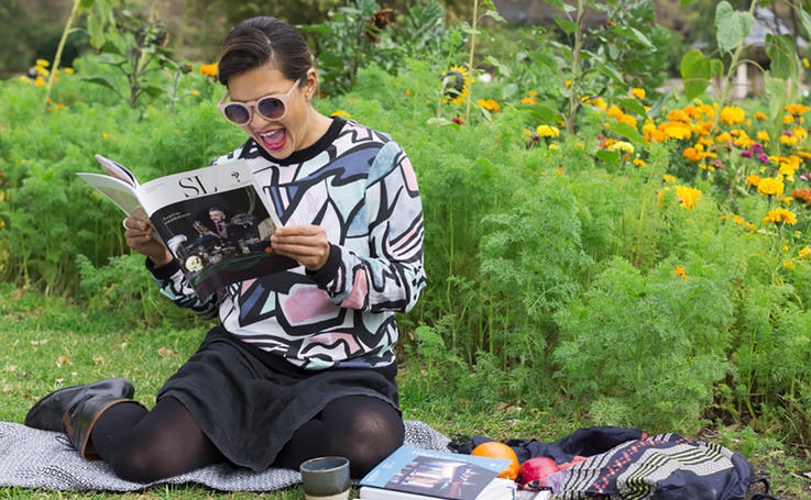Young woman reading SL Magazine