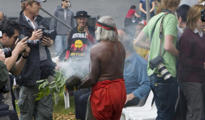 Image of a man conducting a smoking ceremony