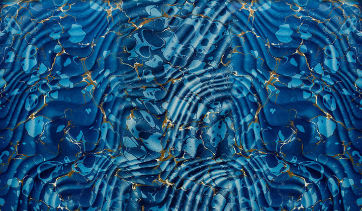 Image of a marbled design in blue and gold.