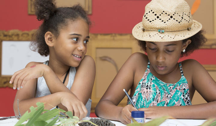 two girls doing craft activities