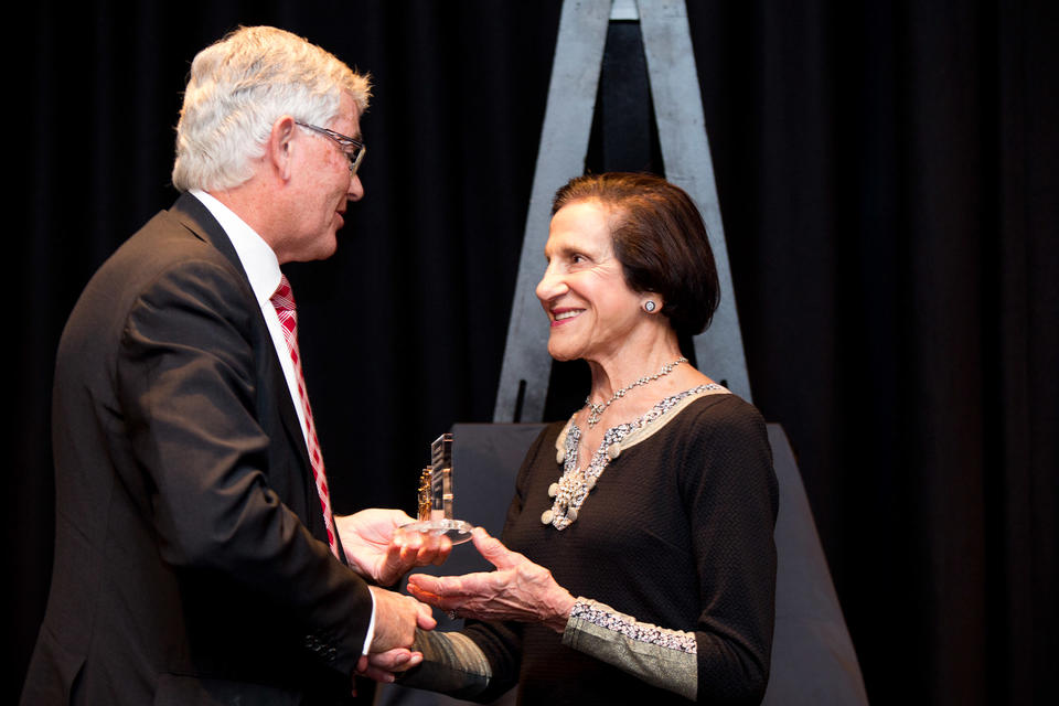 Man and woman holding award