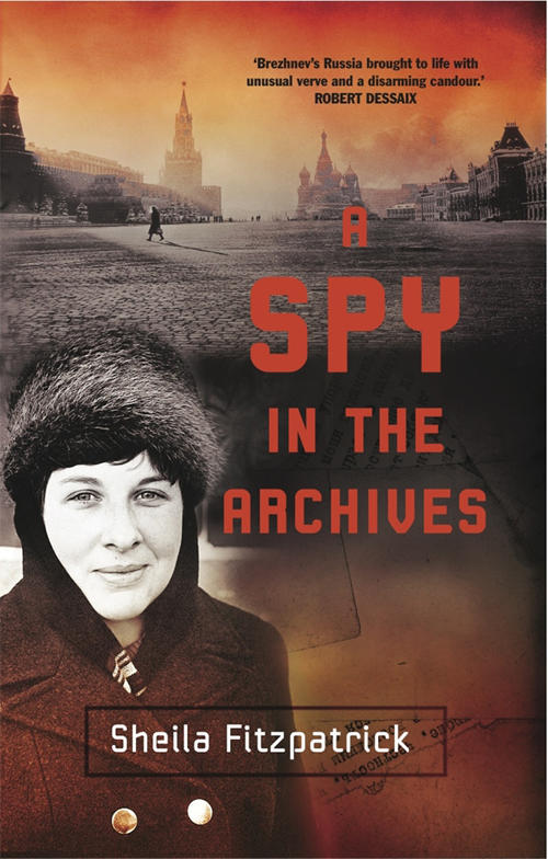 Woman standing in winter clothing with St Petersburg Russia behind on book cover of A Spy in the archives by Sheila Fitzpatrick