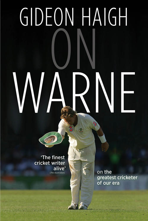 Australian International Cricketer Shane Warne bowing and holding a hat on a cricket field on book cover for On Warne by Gideon Haigh
