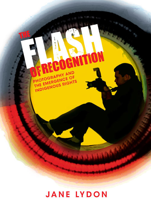 Man sitting in a round object holding a camera on book cover of The Flash of Recognition - Photography and the emergence of Indigenous Rights by Jane Lydon