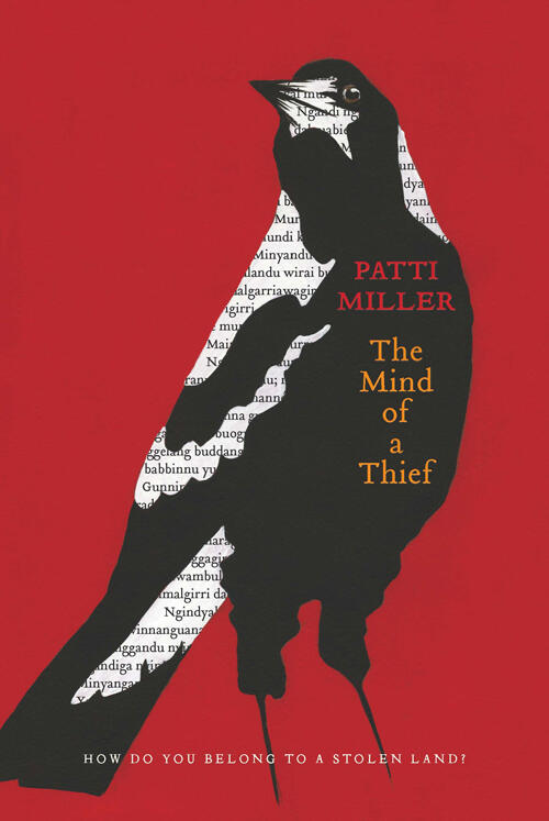 Bird (Magpie) standing on book cover of The Mind of a Thief by Patti Miller