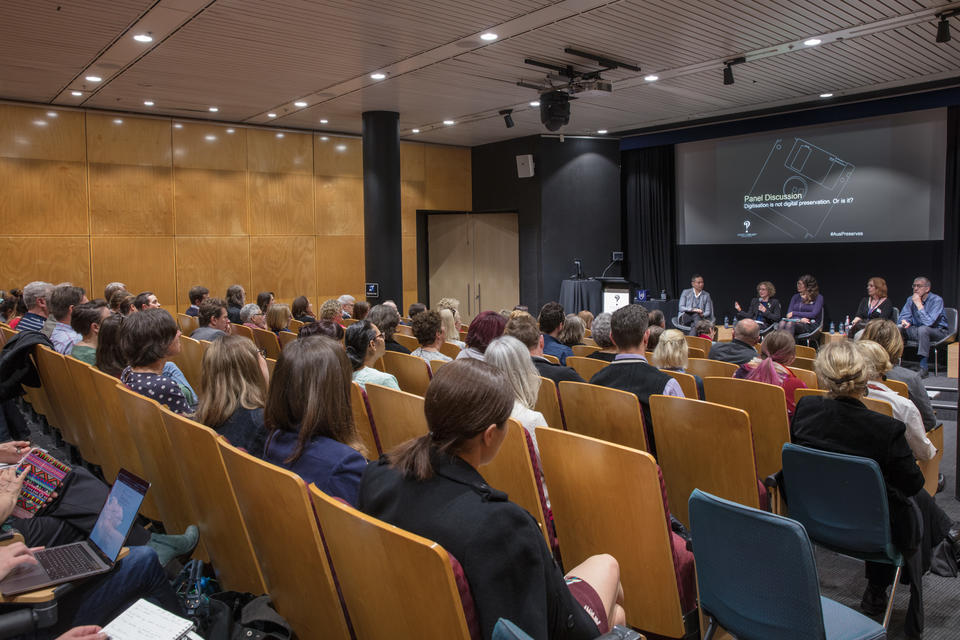 Photograph of the audience and panel discussion in the Metcalfe Auditorium at the Library for Australasia Preserves