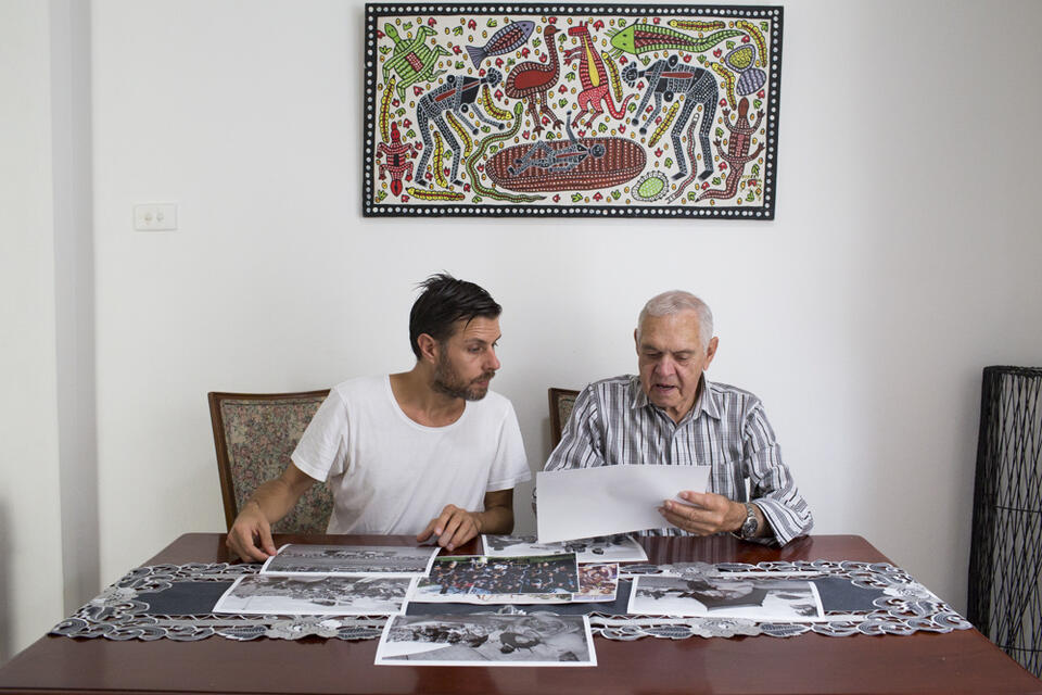 Two men looking at documents