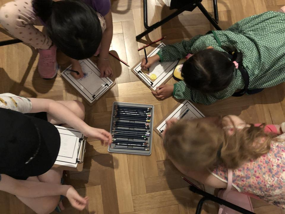 A group of children drawing and colouring in pictures