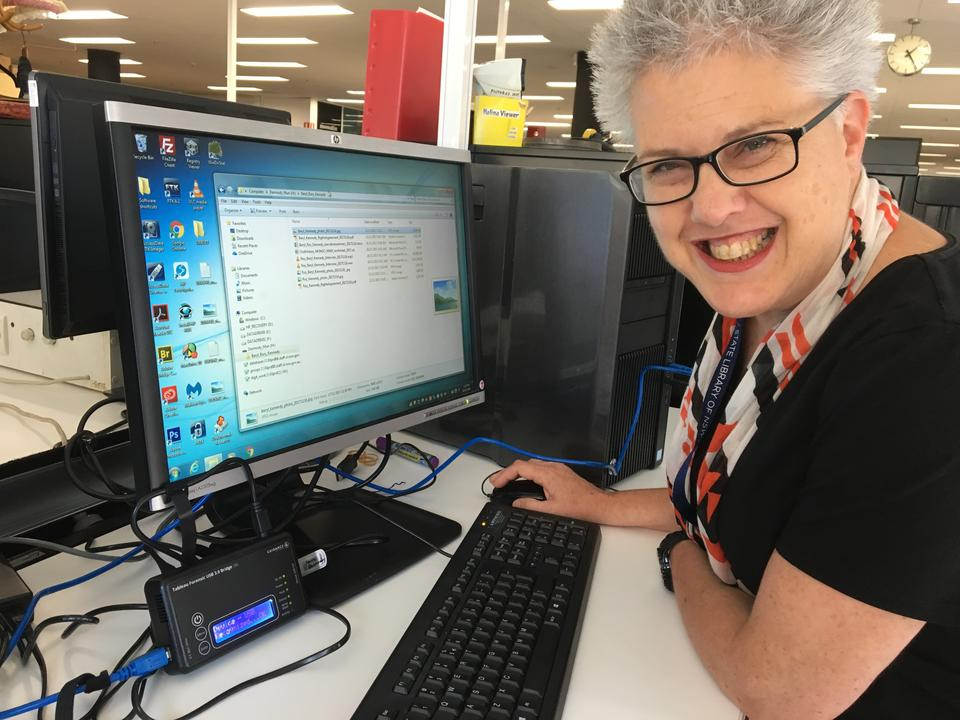 Librarian seated at a computer