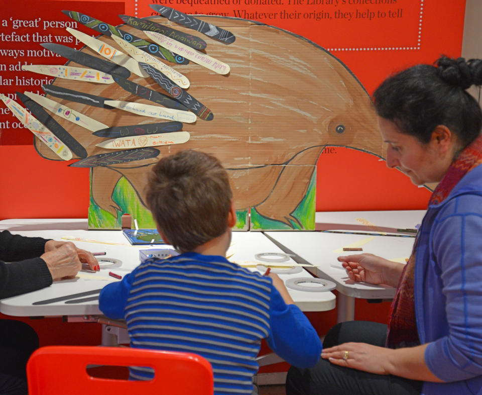 A child and his mother creating craft