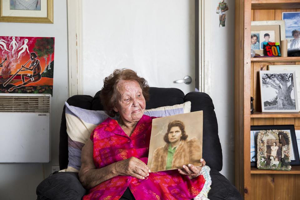 Woman holding sepia photograph