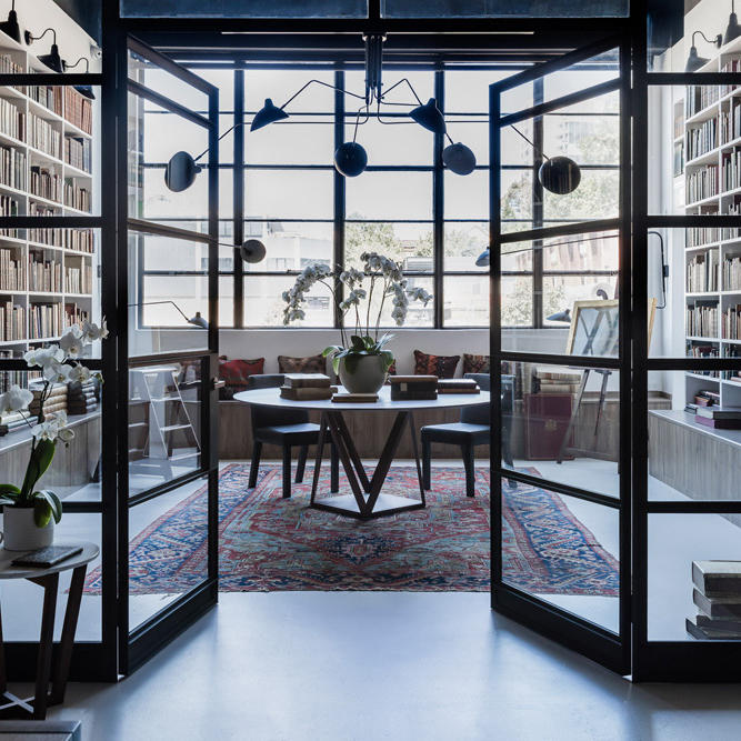 View into a book room with glass doors.