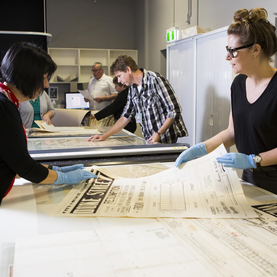 Group of curators scanning in subdivision maps