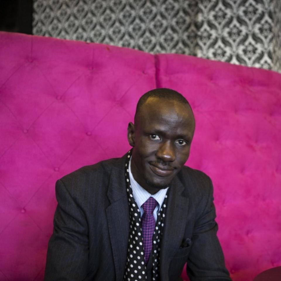 Deng Adut waiting for a coffee