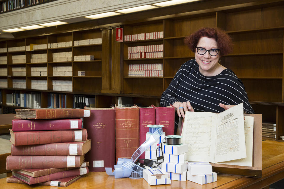 Curator Margot Margot Riley with NSW Government Gazettes