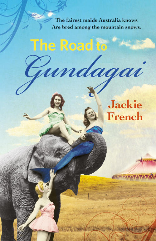 3 girls performing with an elephant with a circus tent behind them on book cover of The Road to Gundagai by Jackie French