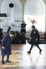 Children in school uniform in a learning space