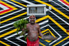 """Uncle Max Eulo begins the day with a smoking ceremony in front of artist Brook Andrew's """"Travelling Colony"""" caravan.  Yabun. Victoria Park, Sydney. Thursday 26th January, 2012"""